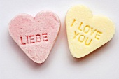 Two peppermint hearts with the words LIEBE (love) & I LOVE YOU
