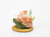Prawns and mayonnaise on cracker