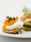 Blini with sour cream and salmon caviar