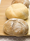 A kaiser roll and a rye roll