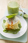 Poached eggs in basil sauce