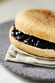 Bread roll filled with blackcurrant jelly