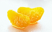 Two segments of mandarin orange
