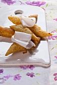 Frigiule con lardo (Fried pastries with lardo)