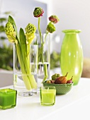 Spring decorations in pale green (flowers, candles, vase)