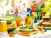 Party buffet: hamburgers, salad and drinks