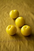 Four yellow plums