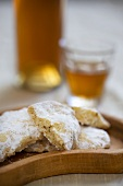 Cookies dusted with icing sugar, iced tea in background