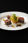 Medallions of beef fillet with potato crisps