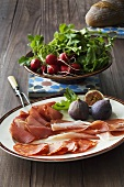 Ham platter with figs and radishes