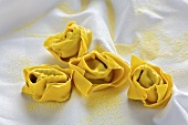 Home-made tortellini with spinach filling