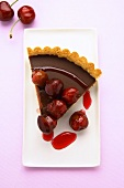 A piece of chocolate cherry tart from above