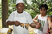Natives of Ecuador cooking maggots