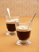 Coffee with cream topping in glasses