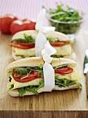 Baguette rolls filled with rocket, egg and tomato