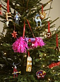 Christmas tree decorated with ornaments, biscuits & sweets