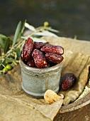 Dried dates in ceramic pot