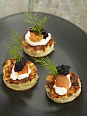 Small tortillas with soft cheese and caviar