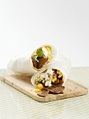 Wraps filled with meat, sweetcorn and salad