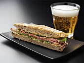 Ham tramezzino, glass of beer