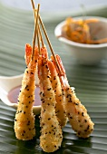 King prawns in coconut & sesame seed coating on skewers