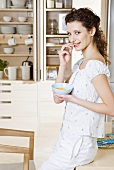 Young woman eating cornflakes