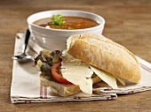 Cheese roll with goulash soup
