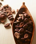 Cocoa beans in and beside wooden dish