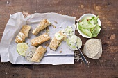Sesame fish fingers with wasabi mayo and cucumber salad