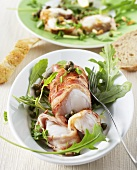Grilled monkfish wrapped in pancetta