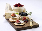 Appetiser: cheese, berries, crackers and figs
