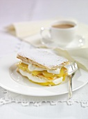 Puff pastry slices with lemon cream and cream