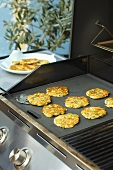 Asparagus and sweetcorn pancakes on griddle