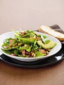 Spinach and avocado salad with bacon