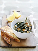 Goat's cheese with chard and chick-peas served with toast