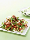 Rocket salad with ham, boiled eggs and avocado