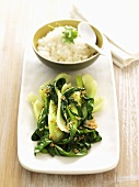 Sautéed pak choi with garlic and a bowl of rice