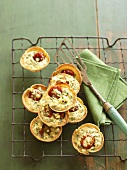 Feta and tomato tartlets on a cake rack