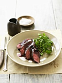 Kangaroo fillet in red wine & juniper sauce, watercress salad
