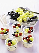 Grape dessert in plastic tubs
