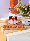 Party buffet with lamb tartlets and Kir Royal