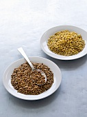 Buckwheat and barley on two plates