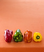 Four peppers (red, green, orange, yellow)