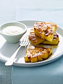 Caramelised pineapple pieces with cream