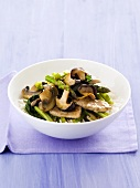 Pork and mushroom stir-fry with green asparagus on rice