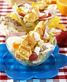 Chicken skewer on salad with egg