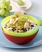 Muesli with milk and fresh fruit