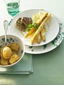 Pork medallions with asparagus gratin and potatoes