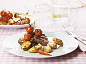Lamb chops with roasted potatoes and cherry tomatoes