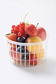 Fruit and berries in a plastic basket